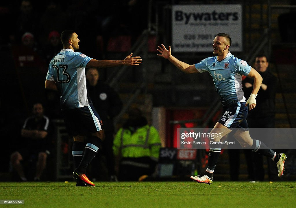 Blackpool's Tom Aldred celebrates scoring his sides second goal with team-mate Colin Daniel during the Sky Bet League Two match between Leyton Orient and Blackpool at Brisbane Road on November 19, 2016 in London, England.