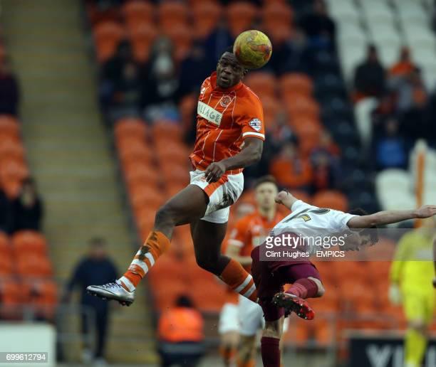 Blackpool's Uche Ikpeazu and Bradford City's Josh Cullen contest a header