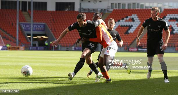 Blackpool's Viv SolomonOtabor battles with Oxford United's John Mousinho during the Sky Bet League One match between Blackpool and Oxford United at...