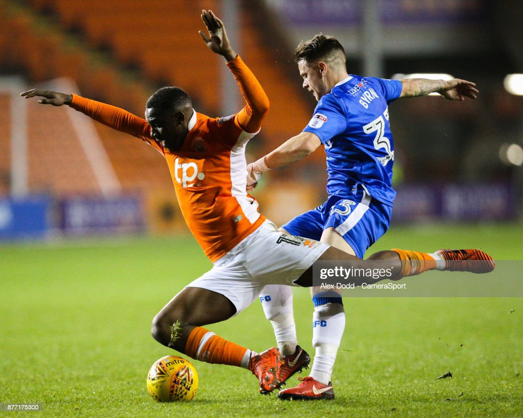 Blackpool's Viv Solomon-Otabor is fouled by Gillingham's Mark Byrne during the Sky Bet League One match between Blackpool and Gillingham at Bloomfield Road on November 21, 2017 in Blackpool, England.