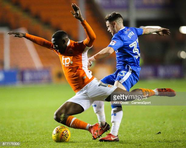 Blackpool's Viv SolomonOtabor is fouled by Gillingham's Mark Byrne during the Sky Bet League One match between Blackpool and Gillingham at Bloomfield...