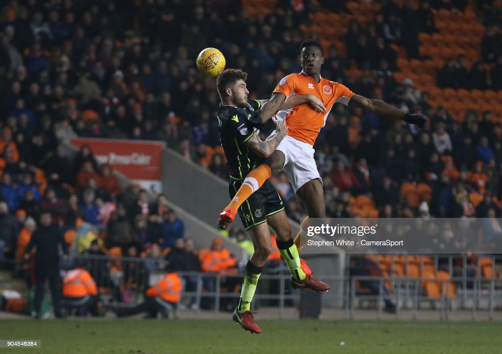 Blackpool's Will Aimson and Bristol Rovers' Tom Nichols during the Sky Bet League One match between Blackpool and Bristol Rovers at Bloomfield Road on January 13, 2018 in Blackpool, England.