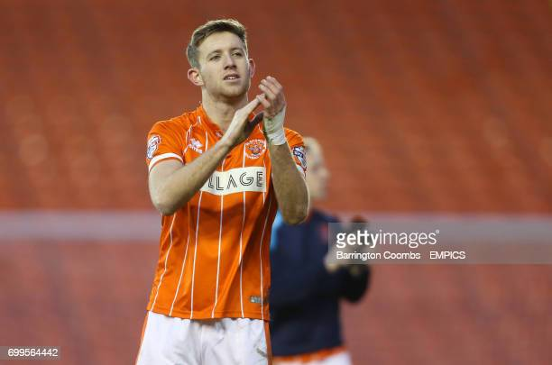 Blackpool's Will Aimson applauds the fans after the final whistle