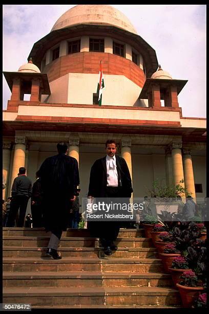 Black-robed lawyers ascending & descending steps to Supreme Court bldg.