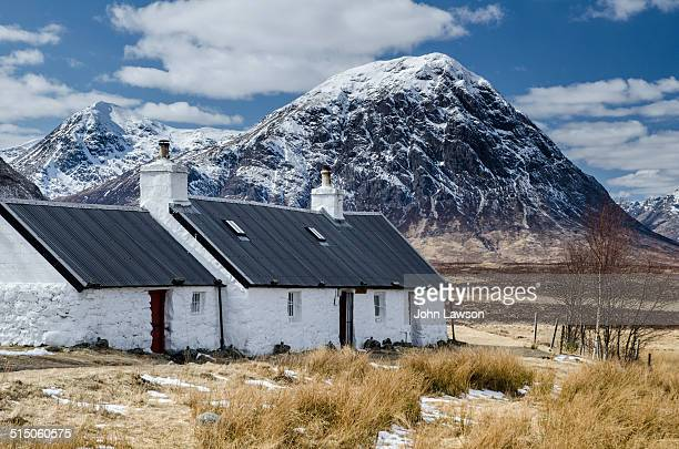 Blackrock Cottage Glencoe Scotland with Buachaille Etive Mor in the background Buachaille Etive Mòr is a mountain at the head of Glen Etive in the...