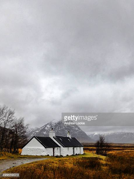 Blackrock Cottage, with the snow capped mountain known as Buachaille Etive Mor in the background. Image taken at Glencoe, the Highlands, Scotland, UK.