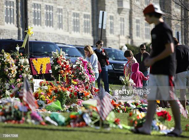 Mourners visit the Hokie stone memorial in honor of the 32 shooting victims 22 April 2007 on the Drill Field of Virginia Tech in Blacksburg Virginia...