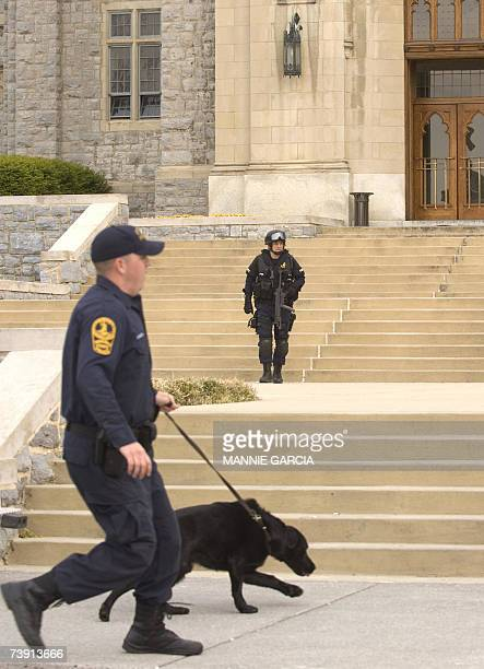 Police respond to a perceived threat 18 April 2007 at Virginia Tech's Burruss Hall in Blacksburg Virginia which sits next to Norris Hall where on 16...
