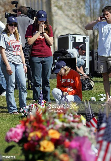 Students look at the Hokie stone memorial after the moment of silence for the victims 23 April 2007 on the campus of Virginia Tech in Blacksburg...