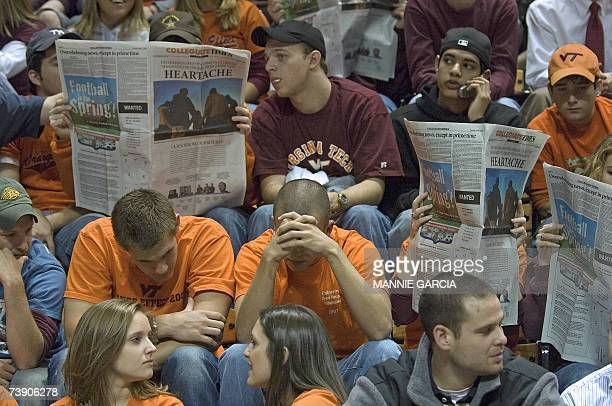 Virginia Tech students read the school newspaper prior to the start of a convocation in Cassell Coliseum at Virginia Tech in Blacksburg Virginia 17...