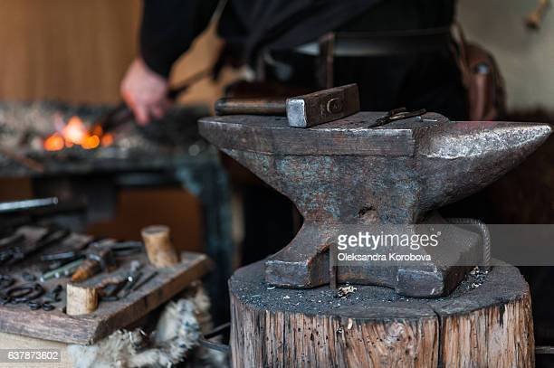 blacksmith at the workshop. - istock images stock pictures, royalty-free photos & images