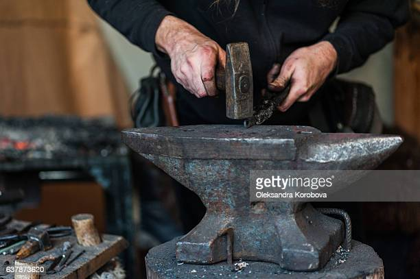 Blacksmith at the workshop.