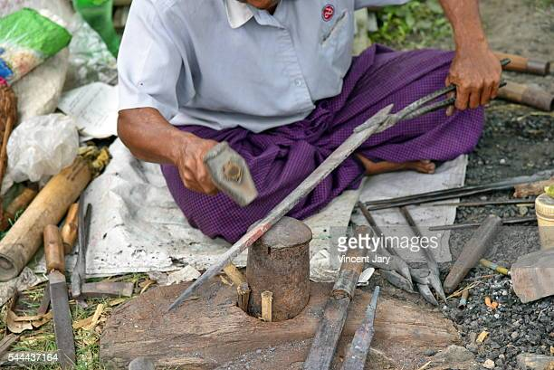 blacksmith at work khaung daing market inle lake myanmar - unmissable stock pictures, royalty-free photos & images