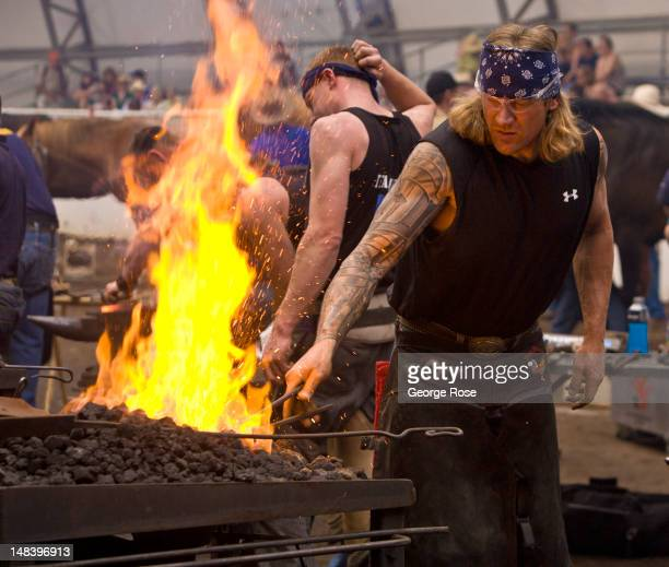 A blacksmith competition to make a set of four horseshoes in the shortest amount of time takes place in a tent near the rodeo grandstand on July 6...