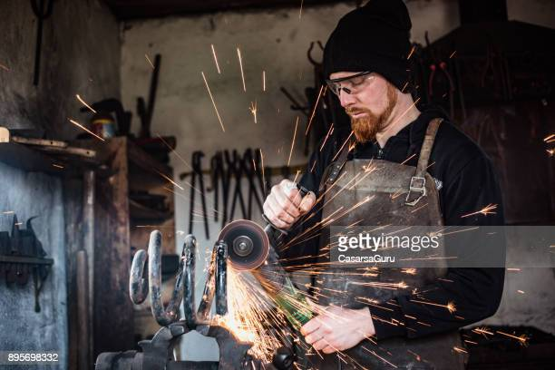 Blacksmith Cutting a Peace of Spring for Forge Material
