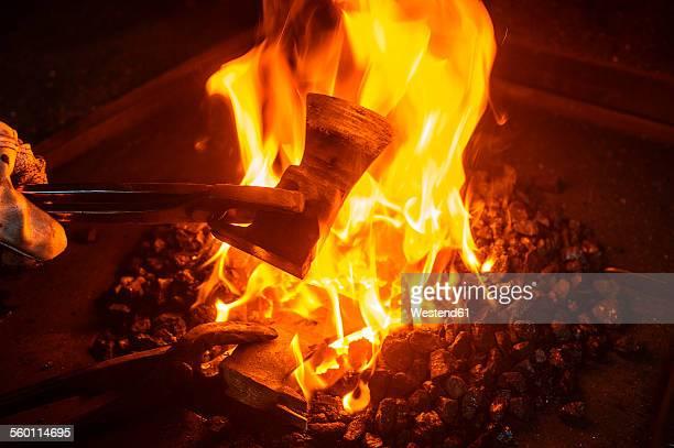 Blacksmith forging hatchet