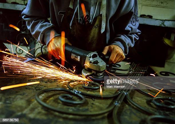 Blacksmith Grinding Metal