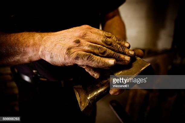 blacksmith holding workpiece - 美術工芸 ストックフォトと画像
