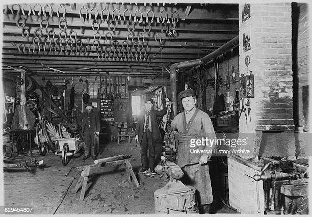 Blacksmith in Cartwright shop circa 1890