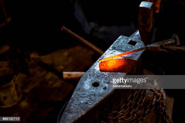 Blacksmith Shaping Knife Using The Forge Tongs