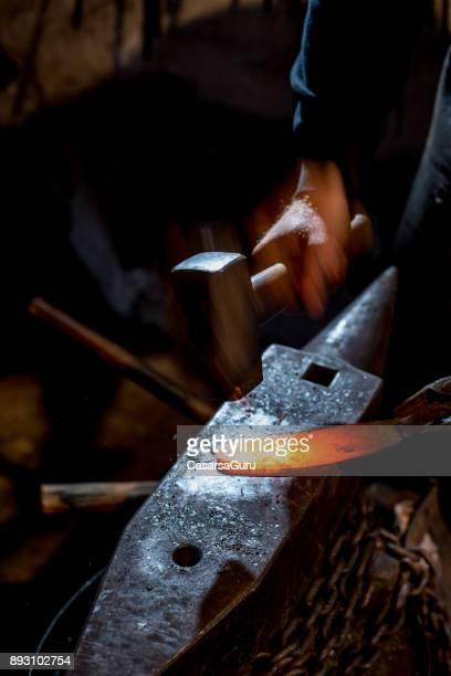 Blacksmith Shaping Knife Using Wooden Hammer