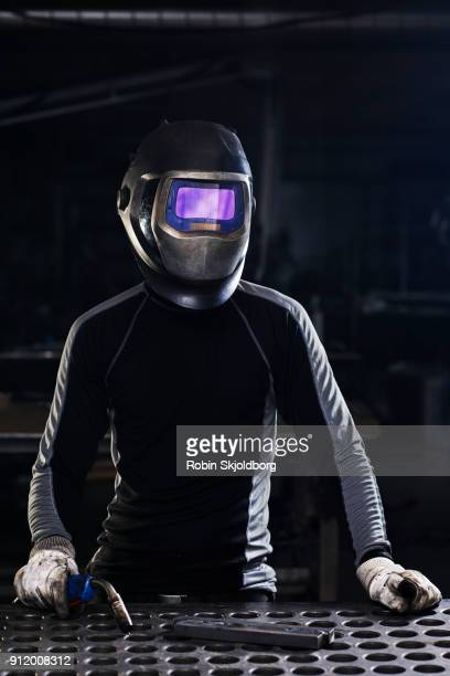 blacksmith wearing protection mask i workshop - robin skjoldborg stock pictures, royalty-free photos & images