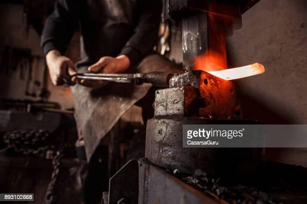 Blacksmith Working Hot Piece Of Metal On Forging Hammer