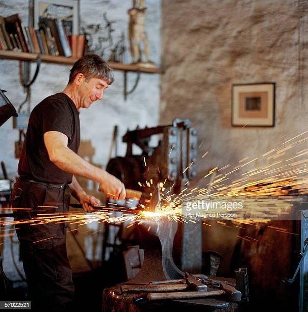 A blacksmith working.