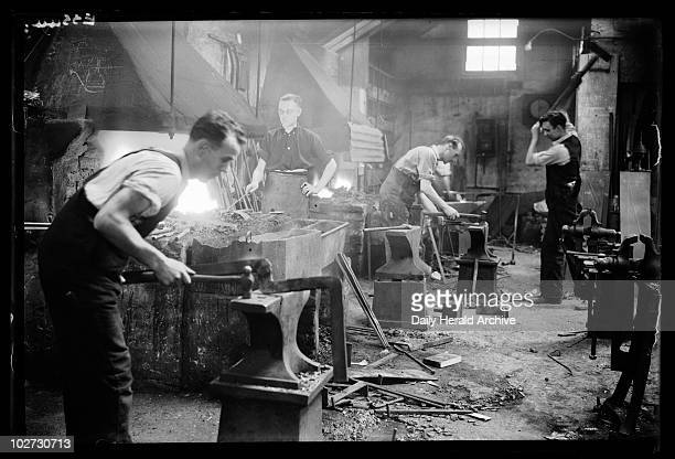 Blacksmiths at work 1935 A photograph of blacksmiths at work in their forge in Camberwell London taken by George Woodbine for the Daily Herald...