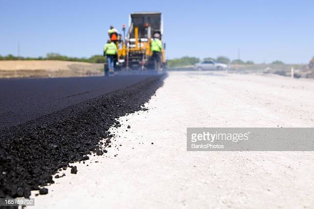 Blacktop Paving Road with Paver and Dump Truck