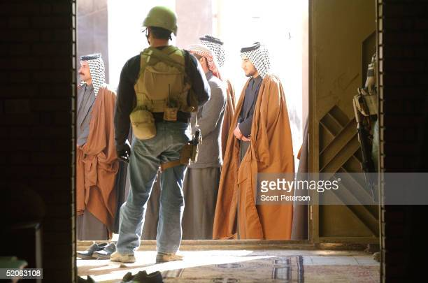 S Blackwater security guards protect US diplomats as they meet with Iraqi Shiites of the large Bani Hassan tribe and its new head Sheikh Muthanna...