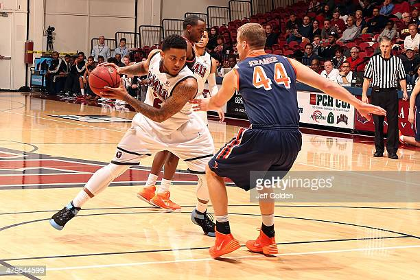 J Blackwell of the Loyola Marymount Lions drives against Malte Kramer of the Pepperdine Waves in the first half of the game at Gersten Pavilion on...