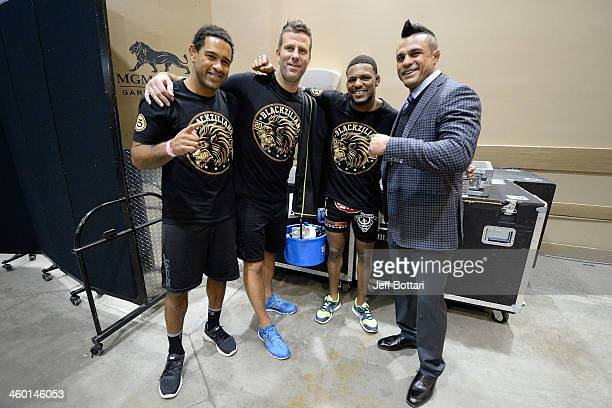 Blackzilian team members Jorge Santiago, Henry Hooft, Michael Johnson and Vitor Belfort pose for a photo backstage during the UFC 168 event at the...