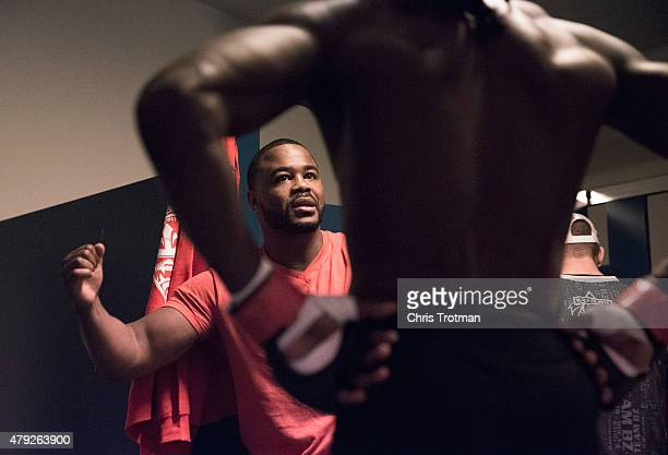 Blackzilian's teammate Rashad Evans talks with Jason Jackson while he warms up before facing Michael Graves during the filming of The Ultimate...