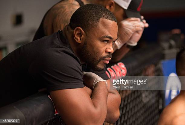 Blackzilian's teammate Rashad Evans watches as Vicente Luque enters the Octagon before facing Hayder Hassan during the filming of The Ultimate...