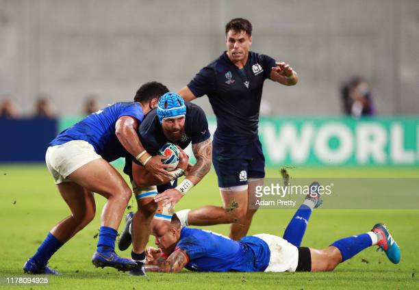 Blade Thomson of Scotland is tackled by Henry Taefu of Samoa during the Rugby World Cup 2019 Group A game between Scotland and Samoa at Kobe Misaki...