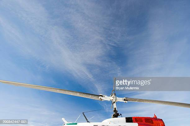 blades of helicopter against sky - helicopter rotors stock photos and pictures
