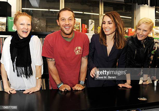 Blag founders Sarah and Sally Edwards pose with actors Tom Hardy and Noomi Rapace at the Blag Magazine 20th anniversary special edition signing at...