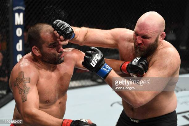 Blagoy Ivanov of Bulgaria punches Ben Rothwell in their heavyweight bout during the UFC Fight Night event at Intrust Bank Arena on March 9 2019 in...