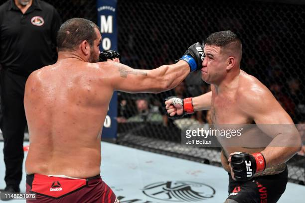 Blagoy Ivanov of Bulgaria punches Tai Tuivasa of Australia in their heavyweight bout during the UFC 238 event at the United Center on June 8 2019 in...
