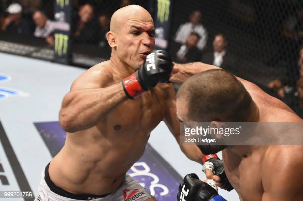 Blagoy Ivanov punches Junior Dos Santos of Brazil in their heavyweight fight during the UFC Fight Night event inside CenturyLink Arena on July 14...