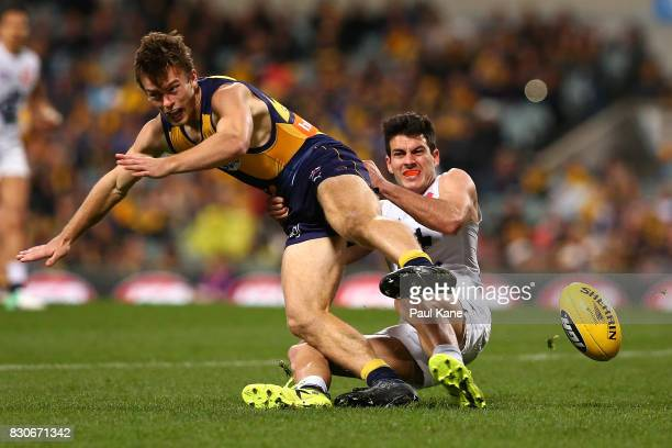 Blaine Boekhorst of the Blues tackles Luke Partington of the Eagles during the round 21 AFL match between the West Coast Eagles and the Carlton Blues...