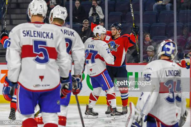 Blaine Byron of the Springfield Thunderbirds scores a goal on Charlie Lindgren of the Laval Rocket and Alexandre Alain of the Laval Rocket Hunter...