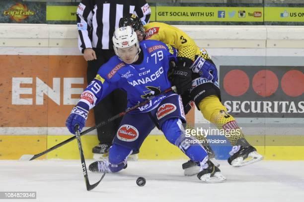 Blaine Down of Villach and Peter Schneider of Vienna during the Vienna Capitals v EC VSV Erste Bank Eishockey Liga at Erste Bank Arena on January 18...
