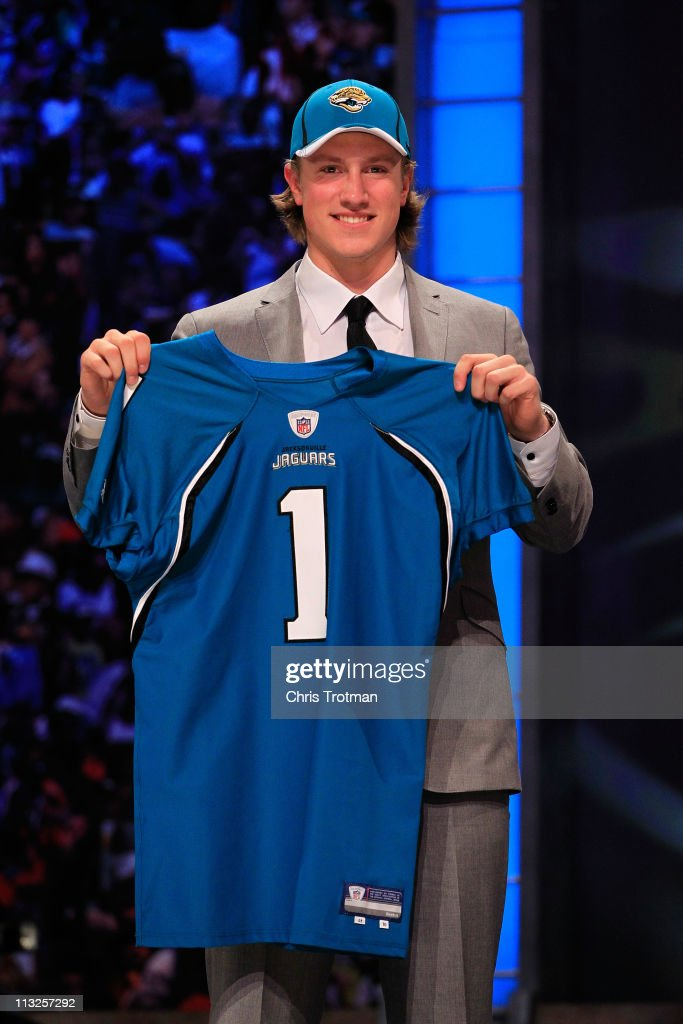 Blaine Gabbert, #11 overall pick by the Jacksonville Jaguars, holds up a jersey during the 2011 NFL Draft at Radio City Music Hall on April 28, 2011 in New York City.