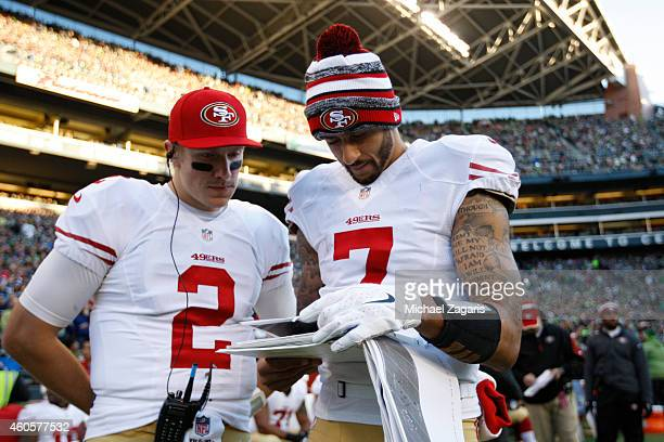 Blaine Gabbert and Colin Kaepernick of the San Francisco 49ers look over game images during the game against the Seattle Seahawks at CenturyLink...