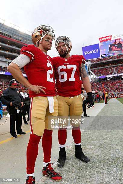 Blaine Gabbert and Daniel Kilgore of the San Francisco 49ers talk on the sideline during the game against the St Louis Rams at Levi Stadium on...