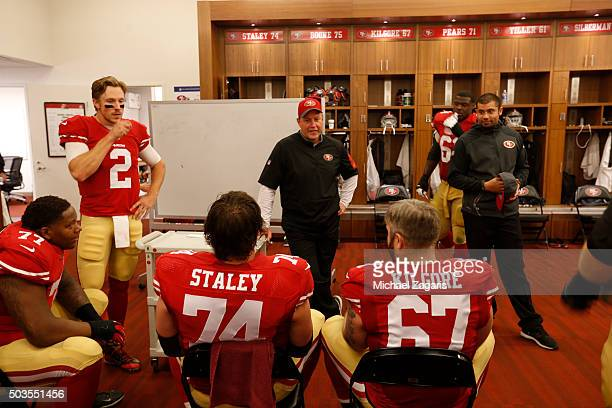 Blaine Gabbert and Offensive Line Coach Chris Foerster of the San Francisco 49ers talk with the offensive line in the locker room during halftime of...