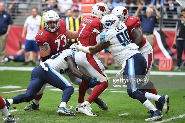 Blaine Gabbert of the Arizona Cardinals is tackled by David King and Jurrell Casey of the Tennessee Titans in the first half at University of Phoenix...