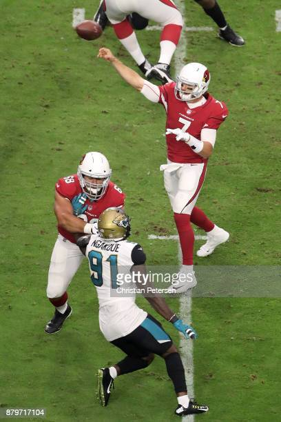 Blaine Gabbert of the Arizona Cardinals makes a pass in the first half of the NFL game against the Jacksonville Jaguars at University of Phoenix...
